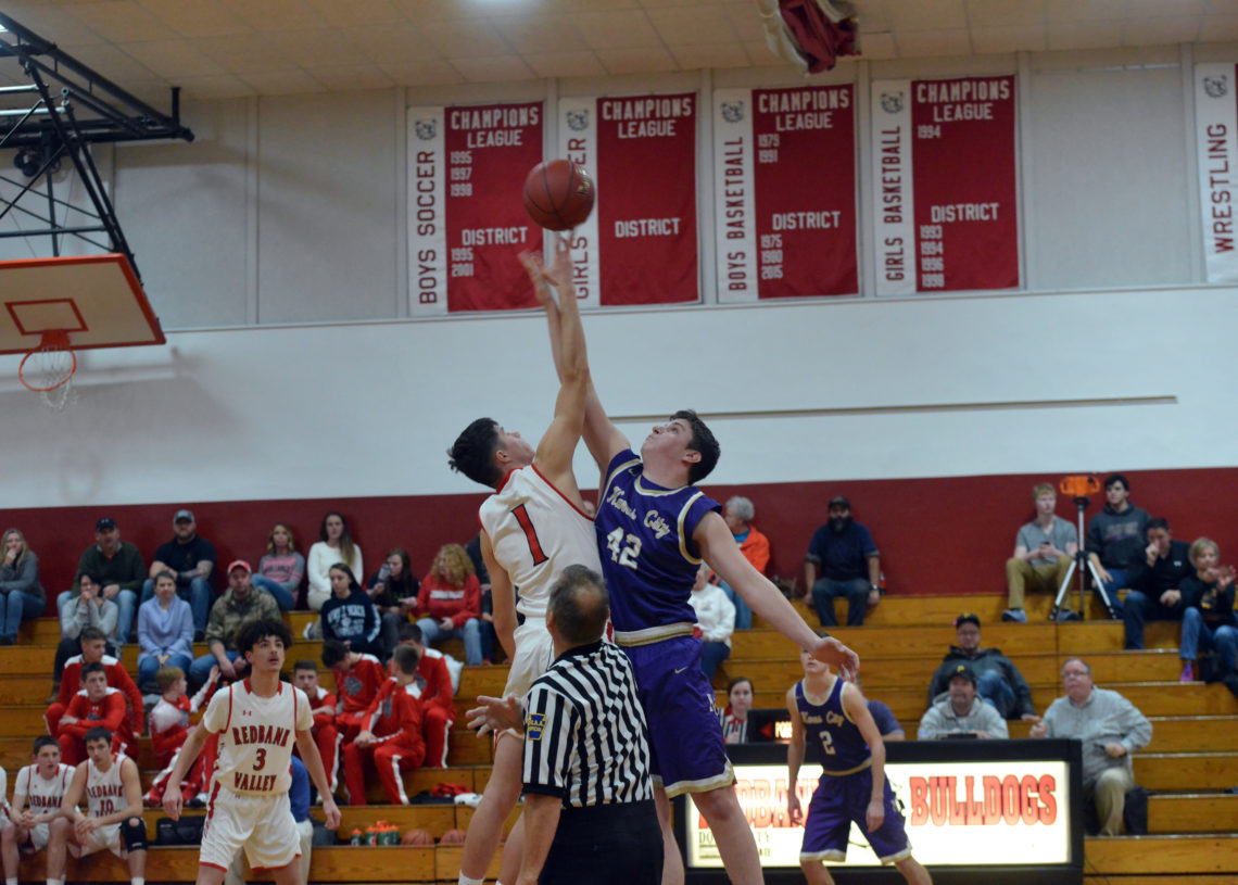 Redbank Valley guard Keaton Kahle (1) and Karns City forward Nathan Waltman (42) contest the opening tip in the teams' KSAC South Division opener on Wednesday night at Redbank Valley Junior-Senior High School in New Bethlehem. Kahle scored 25 points for the Bulldogs, but Waltman and the Gremlins walked away with an 83-59 victory.